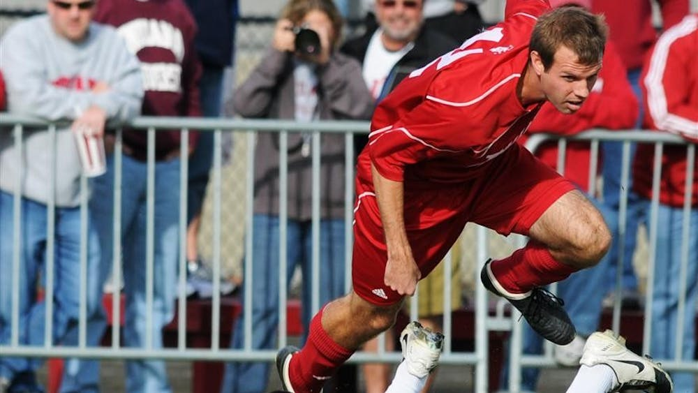 Senior forward Darren Yeagle leaps toward the ball during the second round of the NCAA Men's Soccer Tournament against Butler on Sunday at Bill Armstrong Stadium. IU is currently leading 1-0 with under 10 minutes left to play.