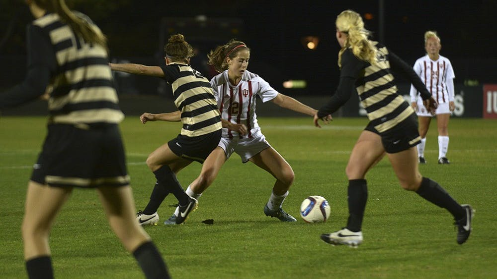 Senior Jessie Bujouves works her way through Purdue University's defense on Wednesday night. IU lost the game 2-0.