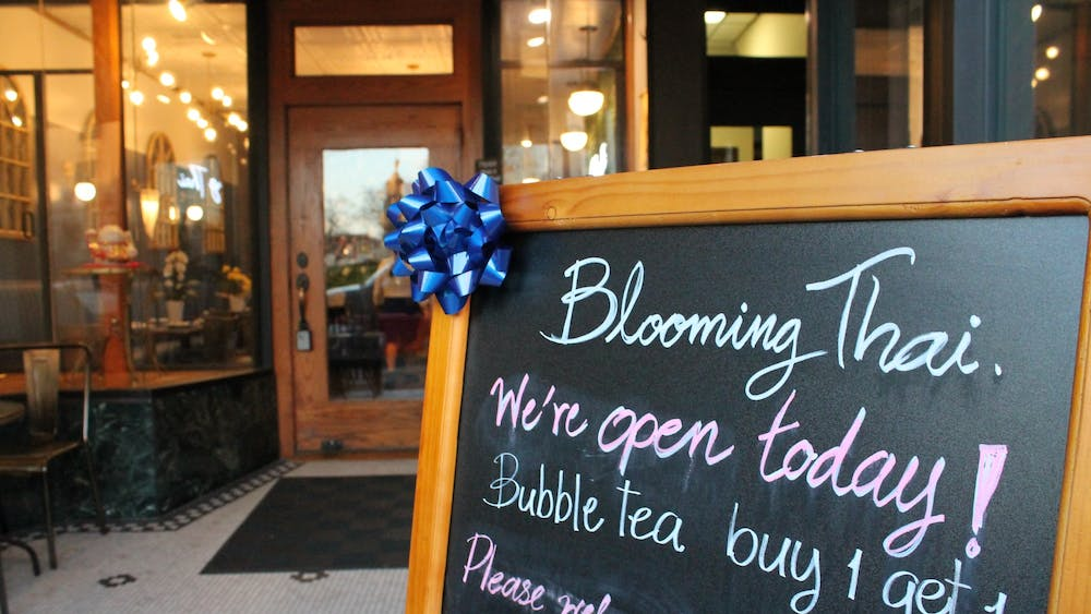 A sign sits Nov. 16 outside Blooming Thai in Bloomington.
