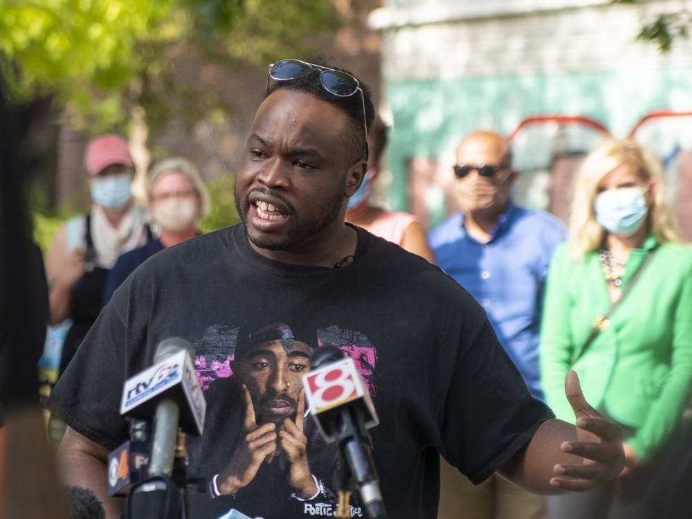 "Vauhxx Booker speaks July 10 in Peoples Park. ""They targeted me, they attacked me, because they thought they could get away with it,"" he said as he spoke on the attack that occurred July 4 near Monroe Lake."