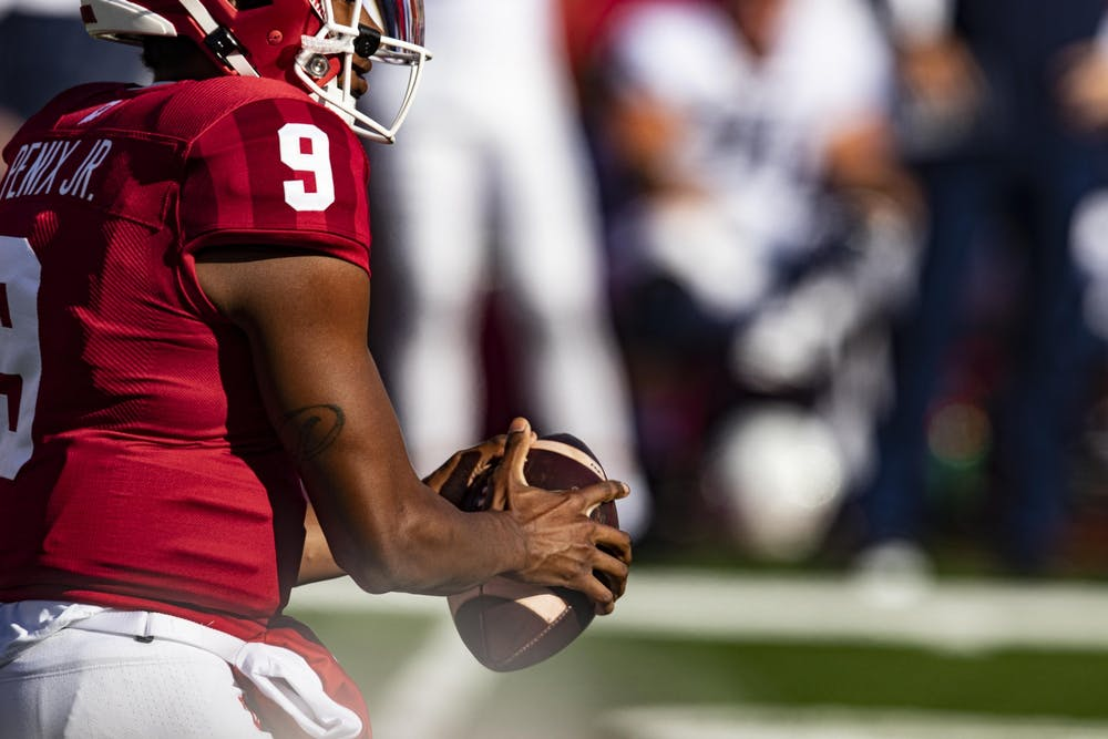 <p>Redshirt sophomore quarterback Michael Penix Jr. holds the ball Oct. 24 in Memorial Stadium. IU looks to improve to 5-1 against Maryland.</p>