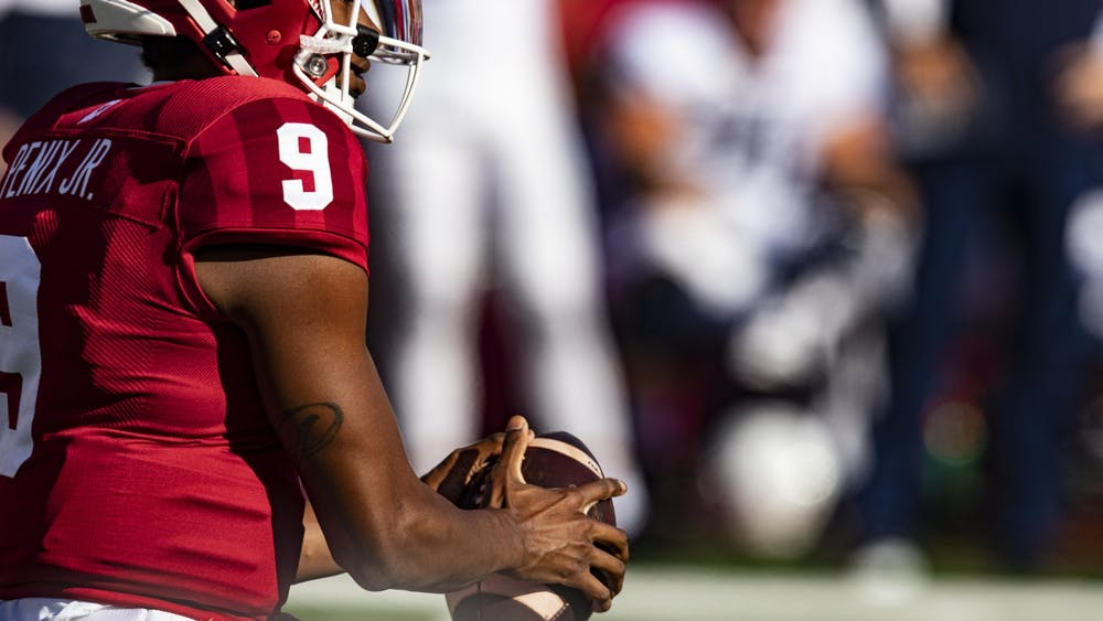 Redshirt sophomore quarterback Michael Penix Jr. holds the ball Oct. 24 in Memorial Stadium. IU looks to improve to 5-1 against Maryland.