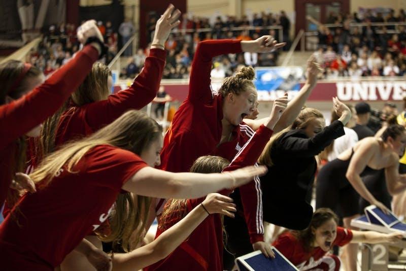 The IU women's swimming team cheers on then-junior, now-senior Shelby Koontz on Feb. 23 in the Counsilman Billingsley Aquatics Center. No. 19 University of Louisville defeated IU on Jan. 31.