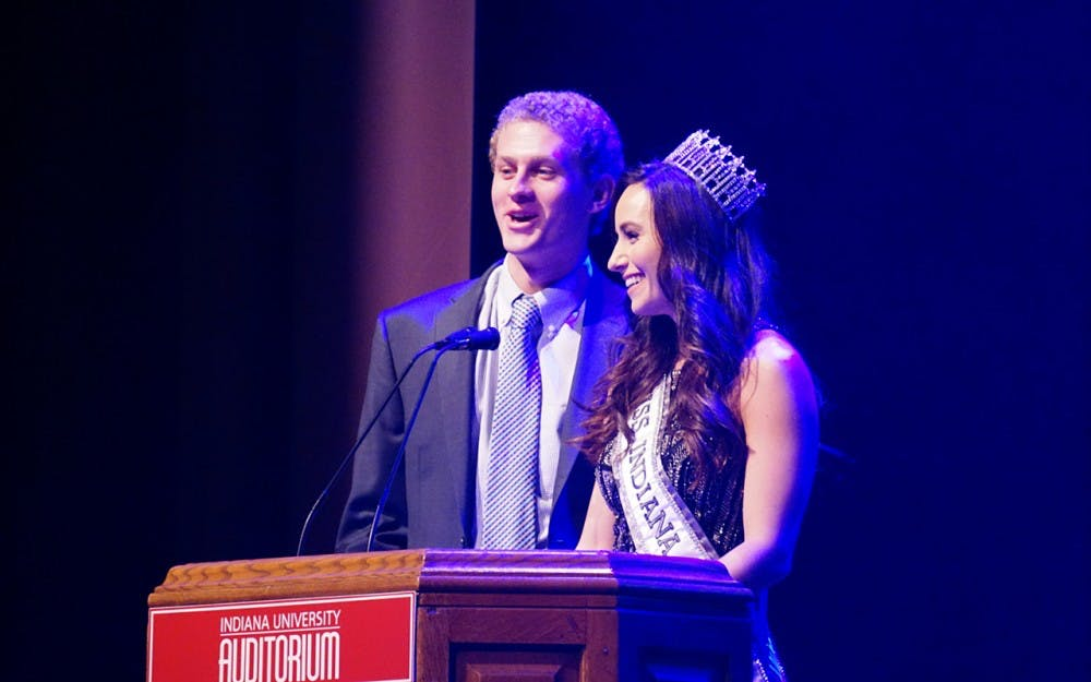<p>Masters of ceremonies&nbsp;Brittany Winchester&nbsp;and Adam Weber introduce this year's Miss Greek IU contestants. This event took place Sunday night in the IU Auditorium.</p>