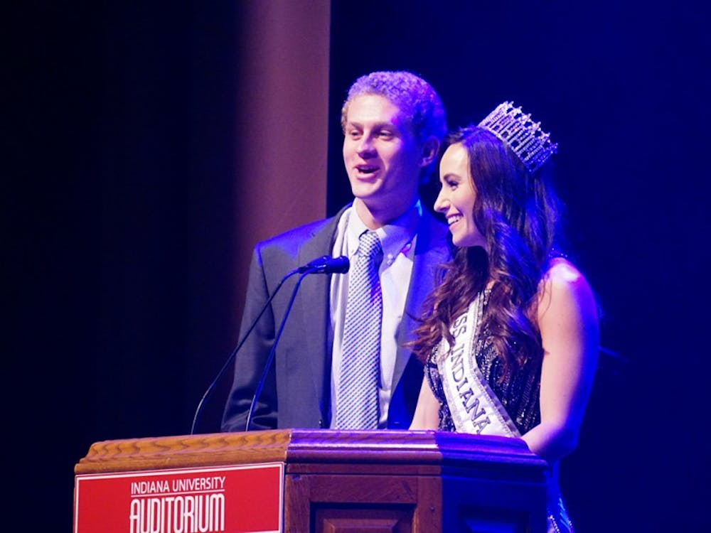 Masters of ceremoniesBrittany Winchesterand Adam Weber introduce this year's Miss Greek IU contestants. This event took place Sunday night in the IU Auditorium.