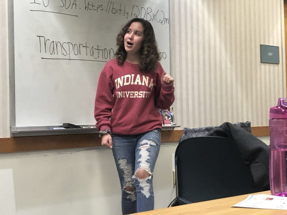Eighth grader Charlotte Siena talks to the Bloomington Students Demand Action group about local state representatives and their stances on gun reform Jan. 27 in Monroe County Library.