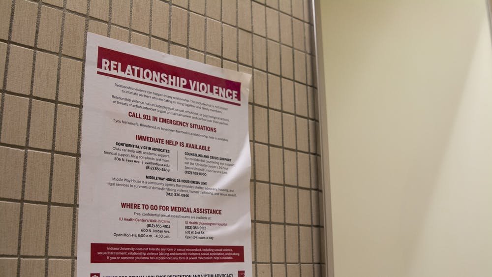 A relationship violence poster hangs on a wall in a bathroom on campus. A recent campus climate survey showed that 82% of students think sexual misconduct is an issue on campus and 74% of students said they think they can do something about sexual misconduct.