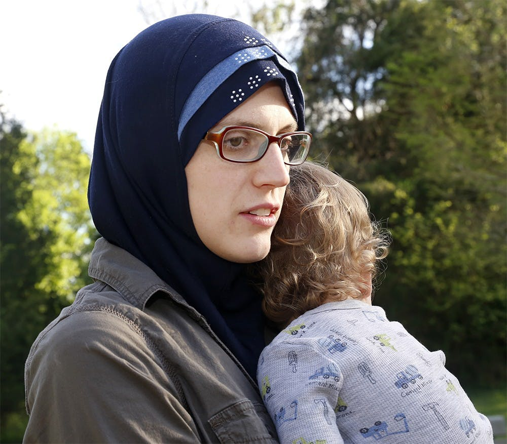 Anna Maidi talks about her experience since she has converted as a muslim Thursday at Sotuheast Park. When Maidi was a freshman at IU, she met her now husband, Chabane. Maidi was introduced to Islam by Chabane and fully converted as a muslim during her study abroad trip in France three years later. She has two children and in active in local Islamic community.
