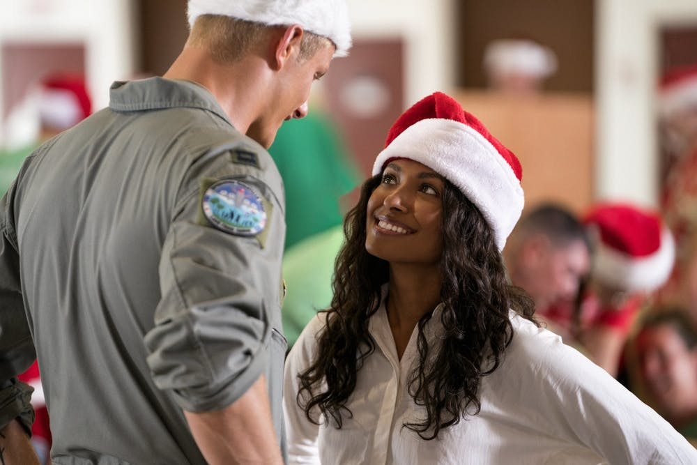 "Alexander Ludwig stars as Capitan Andrew Jantz and Kat Graham stars as Erica Miller in ""Operation Christmas Drop."""