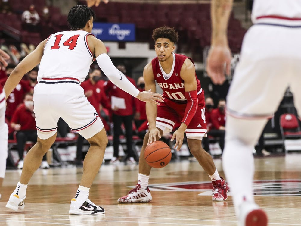 Junior guard Rob Phinisee plays offense against an Ohio State player Saturday at Value City Arena in Columbus, Ohio. The Hoosiers lost 59-78 to the Buckeyes on Saturday.