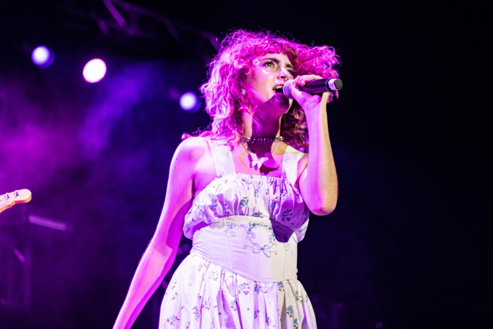 <p>IU junior and Manic Pixie singer Maggie Zielinski performs at the 2021 IU Welcome Week Block Party on Aug. 21. Local artists and art houses are adjusting to performing and operating as COVID-19 restrictions become looser.</p>