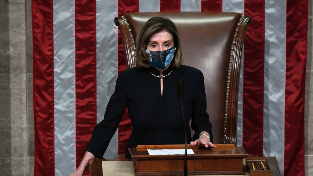 Speaker of the House Nancy Pelosi presides over the U.S. House of Representatives' vote on the impeachment of President Donald Trump on Wednesday at the U.S. Capitol in Washington, D.C. The Democrat-controlled House of Representatives impeached Trump Wednesday for the second time in a year.