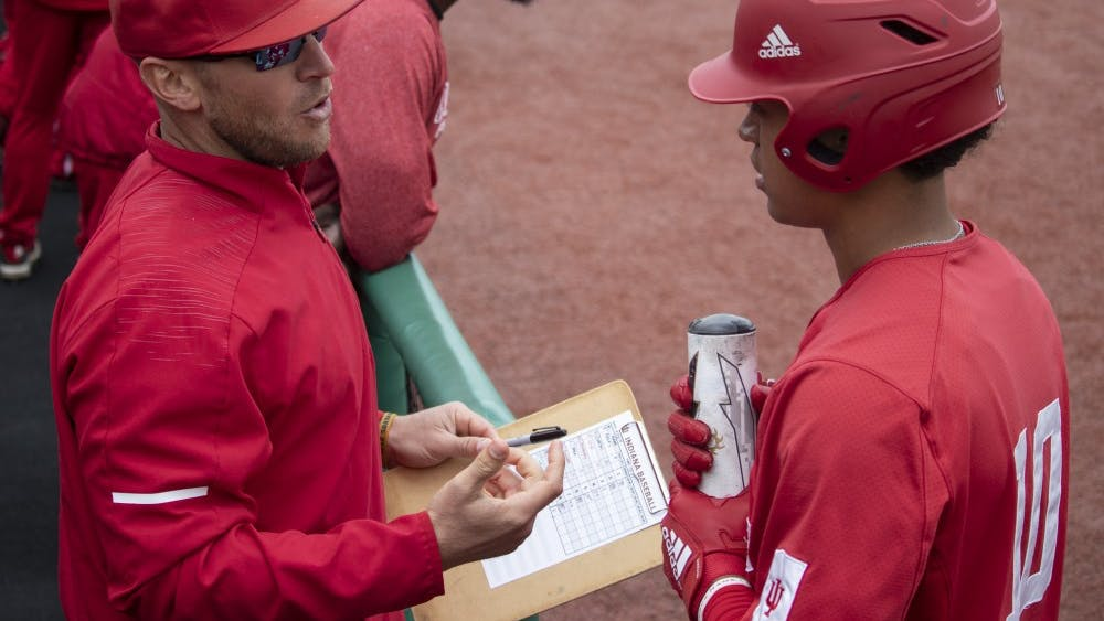 Sophomore infielder Justin Walker talks to Head Coach Jeff Mercer on Sunday, April 28 at Bart Kaufman Field. Walker struck out swinging at the bottom of the first inning.