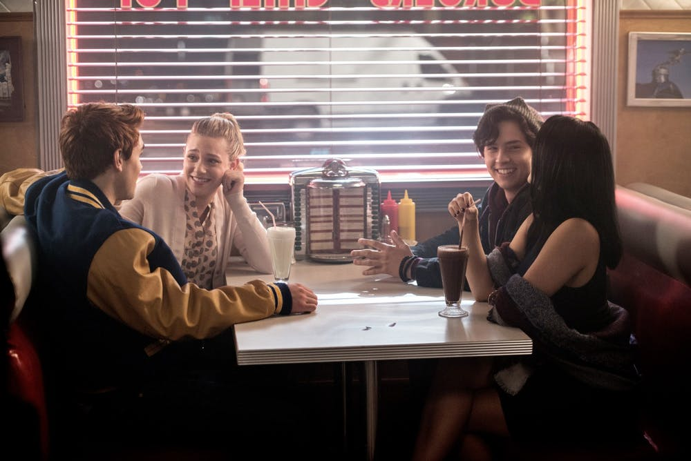 <p>Cole Sprouse, as Jughead Jones, K.J. Apa, as Archie Andrews, Lili Reinhart, as Elizabeth &quot;Betty&quot; Cooper, and Camila Mendes, as Veronica Lodge, appear on the set of &quot;Riverdale&quot; in 2017. </p>