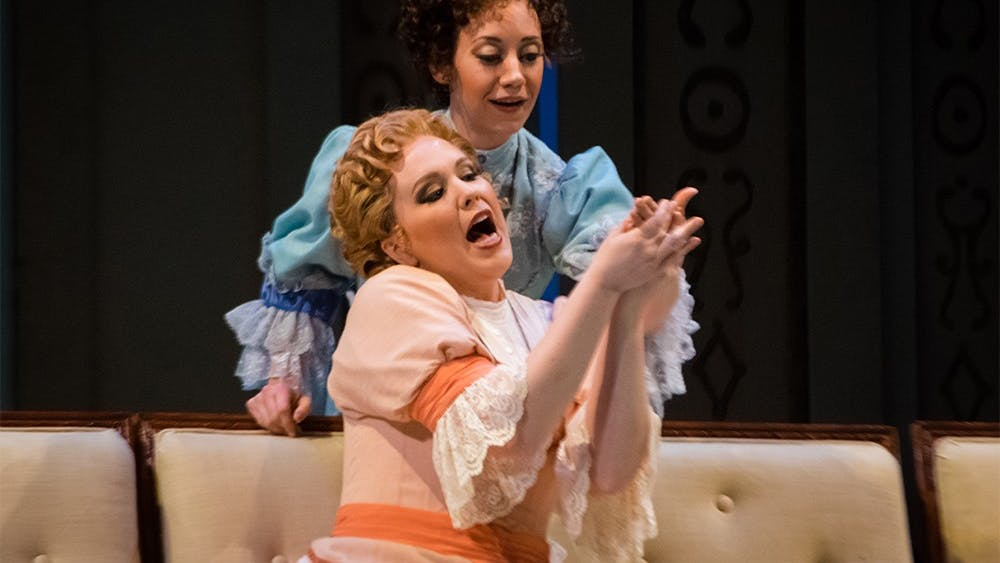 Shannon Love, front, and Rachel Mikol perfom a duet during the Cosi fan Tutte rehearsal Monday at the MAC. Written by Mozart, the Italian opera tells a story of fidelity between two couples.