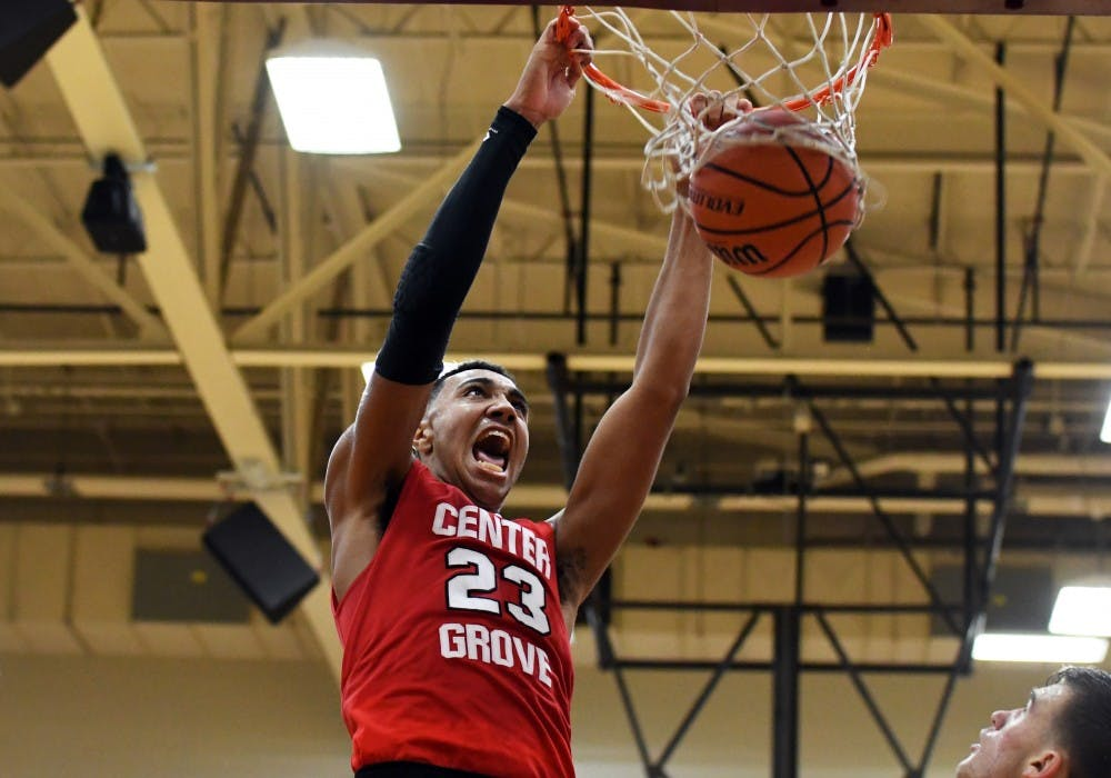 <p>Center Grove's Trayce Jackson-Davis dunks the ball against Bloomington North on Saturday evening at Tom McKinney Court. Jackson-Davis had a double-double with 33 points and 12 rebounds.</p>