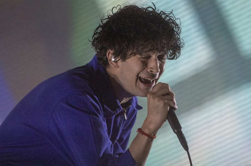 Singer Matty Healy of The 1975 sings onstage during opening day at the Coachella Valley Music and Arts Festival on April 12 on the Empire Polo Club grounds in Indio, California.