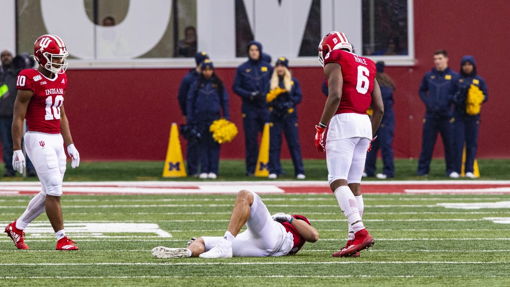 Fifth-year wide receiver Donavan Hale walks up to junior wide receiver Ty Fryfogle on Nov. 23 in Memorial Stadium. Fryfogle was injured by Michigan in the first quarter.