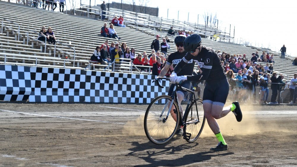 Cutters teammates transition riders during their run March 23 at the Little 500 Qualifications. Cutters was the top qualifier for the men's Little 500 race.