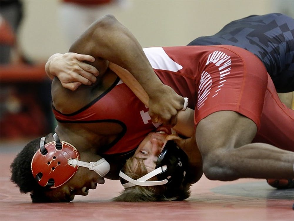 Then-sophomore Elijah Oliver, now a senior, competes in a 125 lbs match with Jhared Simmons from Maryland during the 2016 season at University Gym. Oliver had a fourth-place finish in the 125 lbs. weight class Sunday at the Hokie Open.