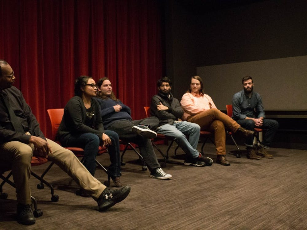 Graduate Media School filmmakers answer audience questions after their work was featured Nov. 2 in the Moving Image Archive Screening Room at Wells Library.