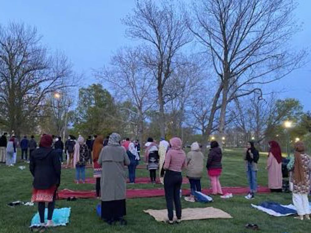 Students gather to pray during the Ramadan Kickoff Iftar on Friday at Dunn Meadow. The 2021 Islamic holy month lasts from April 12 at sundown to May 12.