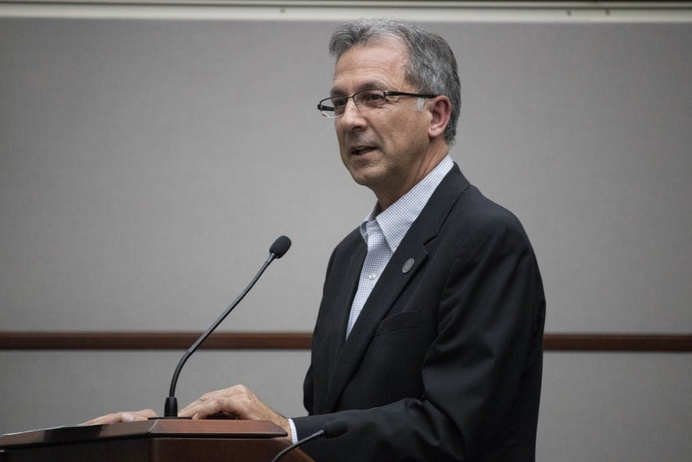 <p>Deputy mayor Mike Renneisen speaks to the council April 3 at the Bloomington City Council meeting in City Hall. Renneisen spoke about whether Bloomington should rebuild or repair the Fourth Street parking garage. </p>