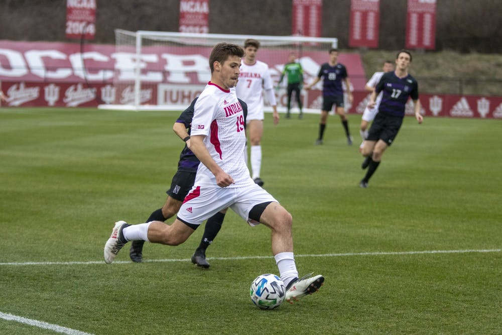 <p>Sophomore Brett Bebej passes the ball March 23 in Bill Armstrong Stadium. IU will compete against Northwestern in the Big Ten Men&#x27;s Soccer Tournament this weekend.</p>