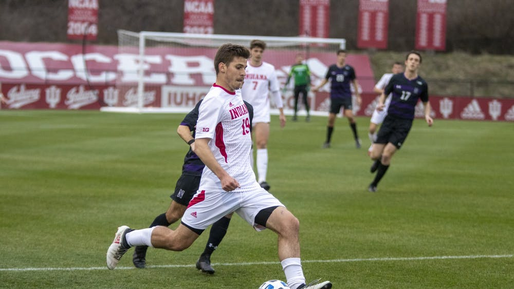Sophomore Brett Bebej passes the ball March 23 in Bill Armstrong Stadium. IU will compete against Northwestern in the Big Ten Men's Soccer Tournament this weekend.
