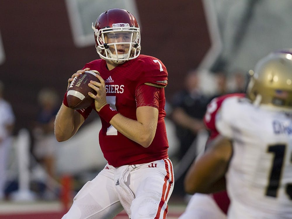 Quarterback Nate Sudfeld prepares to pass the ball during IU's 41-35 loss to Navy on Sept. 6, 2012, evening at Memorial Stadium.