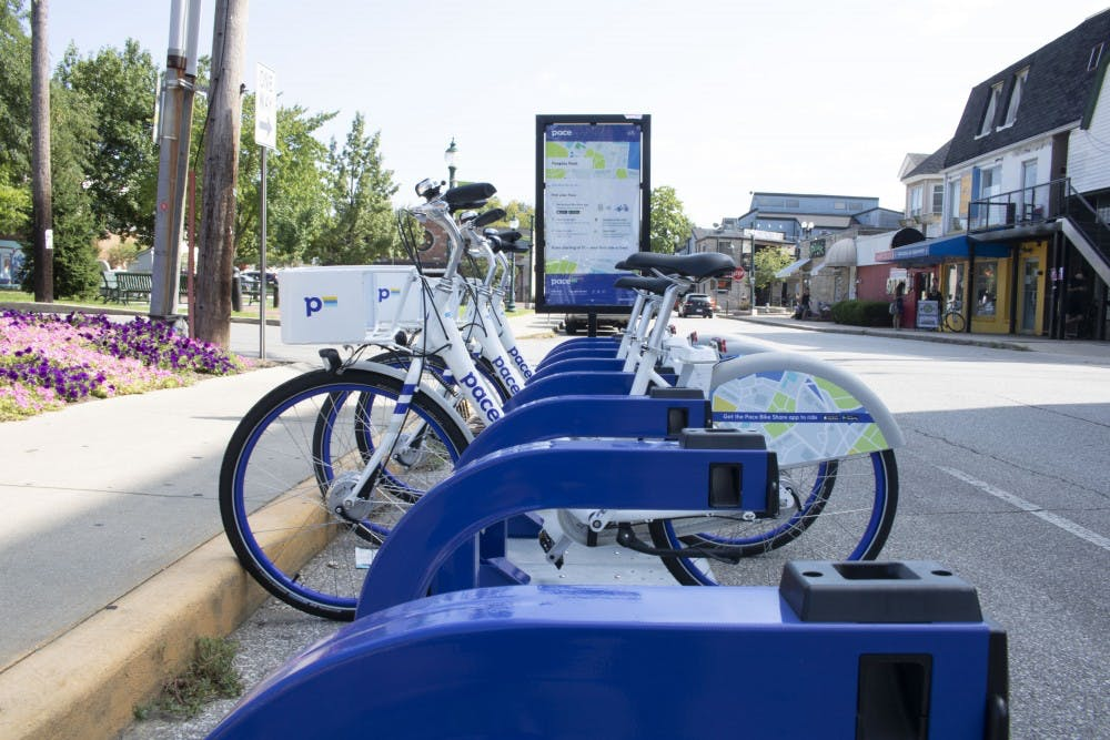 """<p>A set of """"pace bicycles"""" are set in the north Dunn Street near the Peoples park.</p>"""