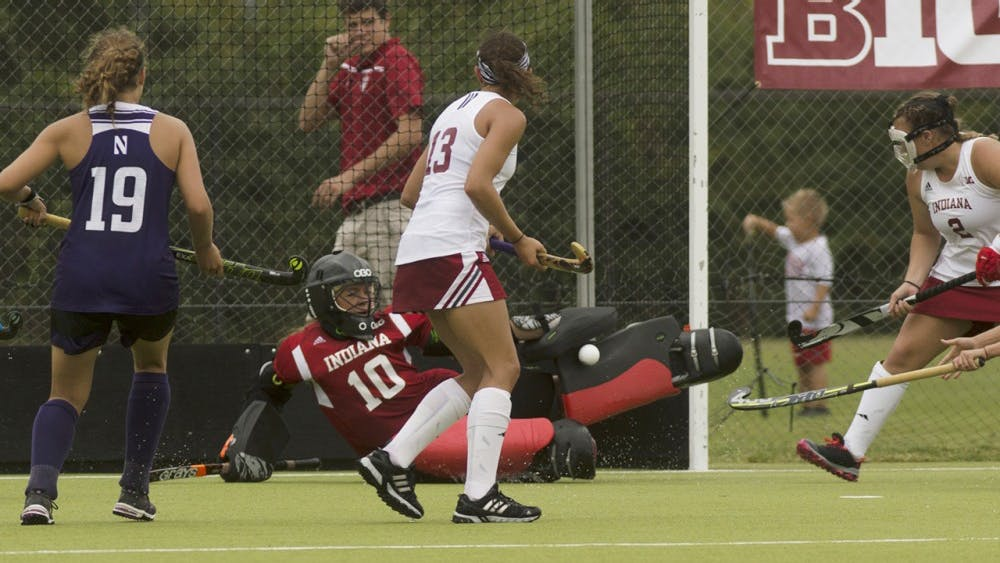 Then-freshman goalkeeper Noëlle Rother blocks a shot on goal during a game against Northwestern at the IU Field Hockey Complex on Spet. 27, 2015.
