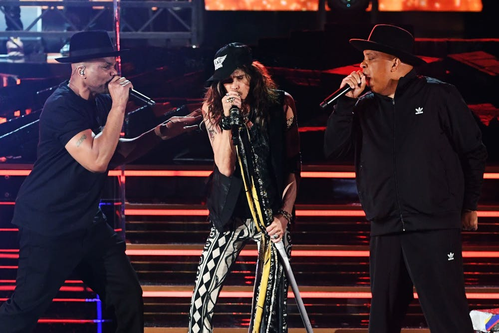 <p>Joseph Simmons of Run D.M.C., left,  Steven Tyler of Aerosmith, middle, and Darryl McDaniels of Run D.M.C., right, perform onstage during the 62nd Annual Grammy Awards Jan. 26, 2020, atSTAPLES CenterinLos Angeles.</p>