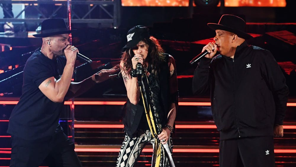Joseph Simmons of Run D.M.C., left,  Steven Tyler of Aerosmith, middle, and Darryl McDaniels of Run D.M.C., right, perform onstage during the 62nd Annual Grammy Awards Jan. 26, 2020, atSTAPLES CenterinLos Angeles.