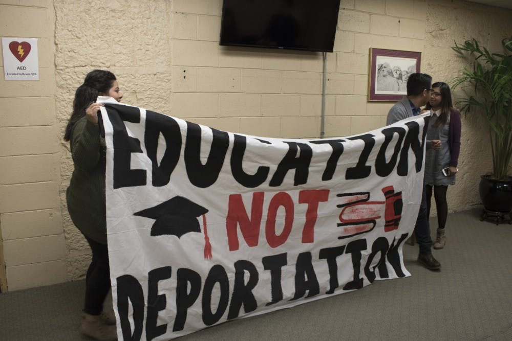<p>Ball State University students Mari Lynne Cruz, Alex Galan and Erika Espinoza display their banner in support of sanctuary campuses. After trying to display it during the senate hearing, they were immediately shut down by senators.</p>