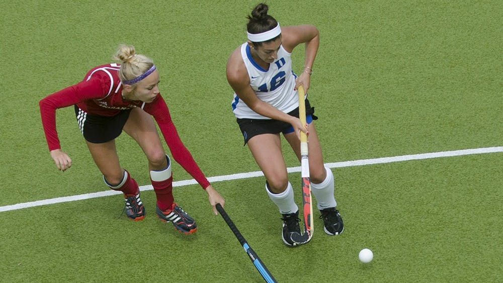Senior midfielder Corinne Karch defends against Duke defender Alexa Mackintire during IU's game against the Blue Devils on Sunday. IU scored three unanswered points to beat No. 4 Duke, 3-2.