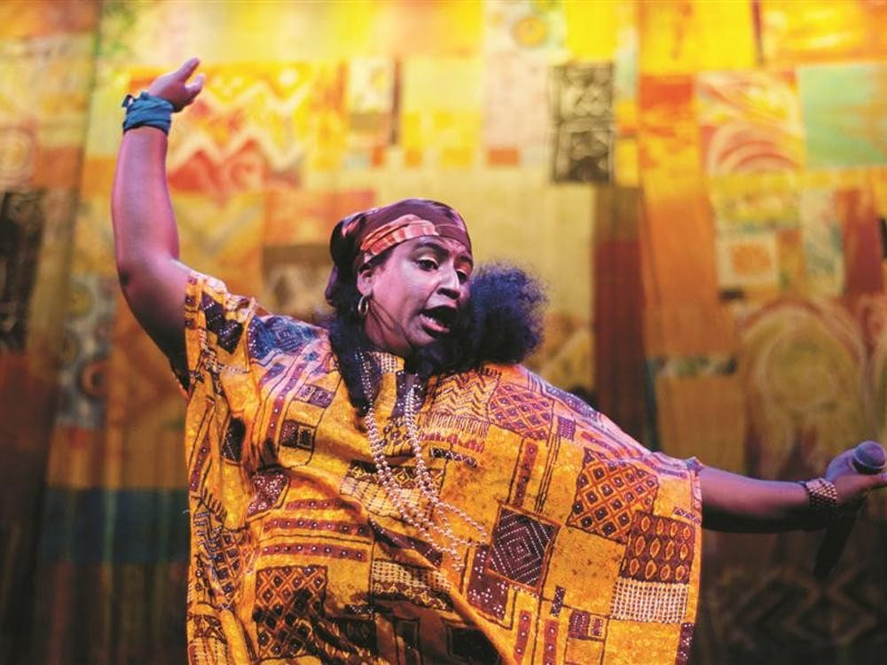 Yara Castellanos Diaz performs with the Creole Choir of Cuba on Friday at the Buskirk-Chumley Theater. The group of 10 Haitian descendents formed in 1994 in Camagüey, Cuba, and is currently on their first major United States tour, with 30 performances in 21 cities across the country.