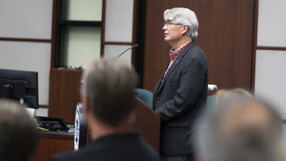 Mayor John Hamilton speaks at the city council meeting Oct. 4 evening to endorse Ordinance 17-39, which authorized an agreement between the City of Bloomington and Cook Medical. The Bloomington City Council voted Wednesday night to approve a deal made with Cook Group Inc. which would allow the Bloomington-based company to pay the city fees in exchange for not being annexed into the city limits.