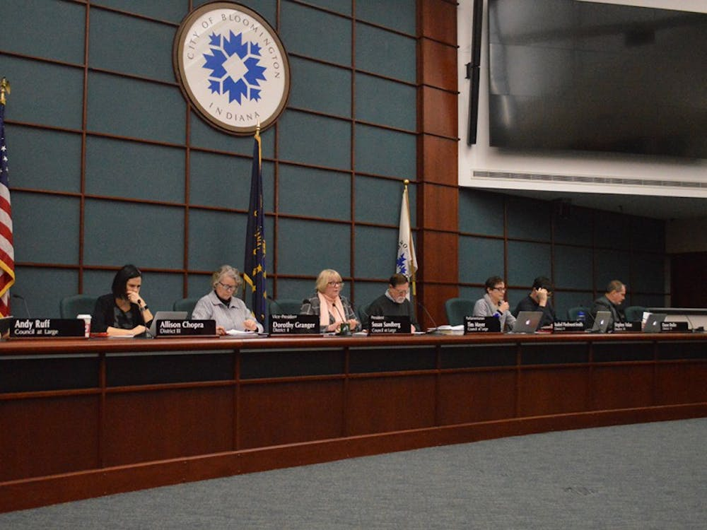 Members of the Bloomington City Council meet Wednesday evening at City Hall. Each of the seven areas up for annexation were individually considered as resolutions during the meeting.