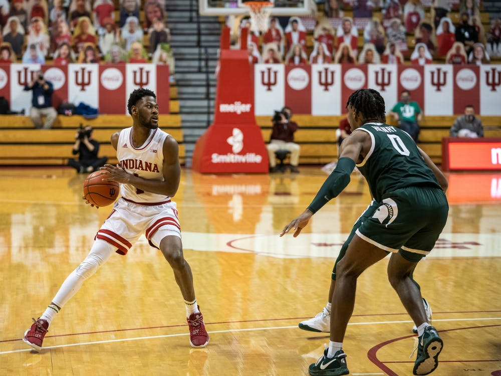 Senior guard Al Durham looks to make a pass Feb. 20 at Simon Skjodt Assembly Hall. Durham has entered the transfer portal as a graduate transfer.
