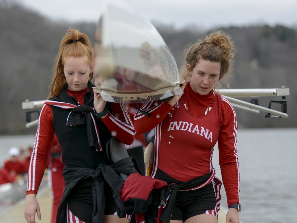 Then-sophomore Sophia Wickersham, now a junior, and then-junior Caroline Taylor, now a senior, move their boat after competition during the 2017 season. IU traveled north to Michigan this weekend, and lost to Michigan State.