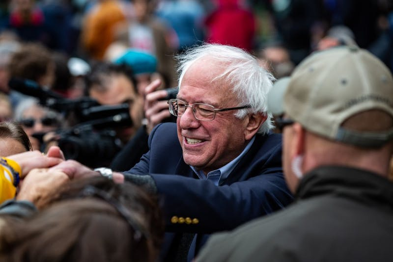 Sen. Bernie Sanders, I-Vt., shakes hands with people after speaking at a rally for congressional candidate Liz Watson on Oct. 19, 2018, in Dunn Meadow.
