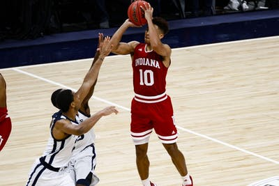 Freshman guard Rob Phinisee attempts the game-winning three-pointer for IU against Butler University on Dec. 15 at Bankers Life Fieldhouse in Indianapolis. Phinisee's shot went in as time expired, giving IU a 71-68 victory.