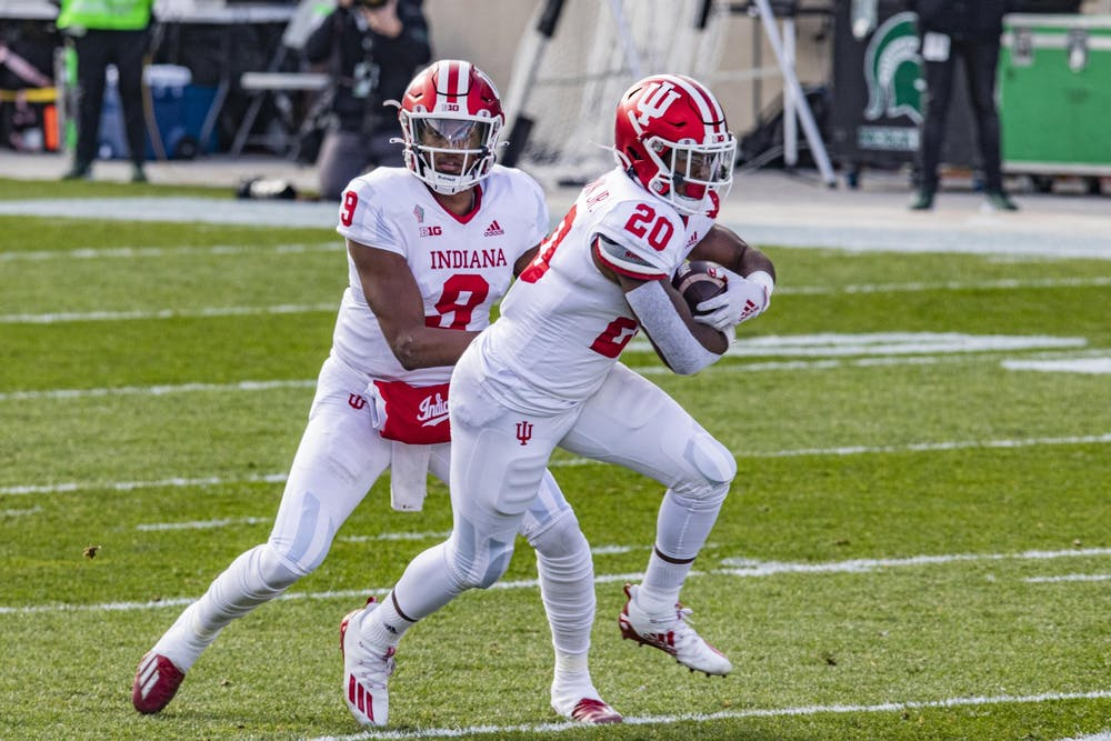 <p>Then-sophomore quarterback Michael Penix Jr. passes the ball to then-freshman running back Tim Baldwin Jr. on Nov. 14, 2020, in Spartan Stadium in East Lansing, Michigan. Baldwin entered the NCAA transfer portal, Indiana football head coach Tom Allen said in a press conference Monday. </p><p></p>