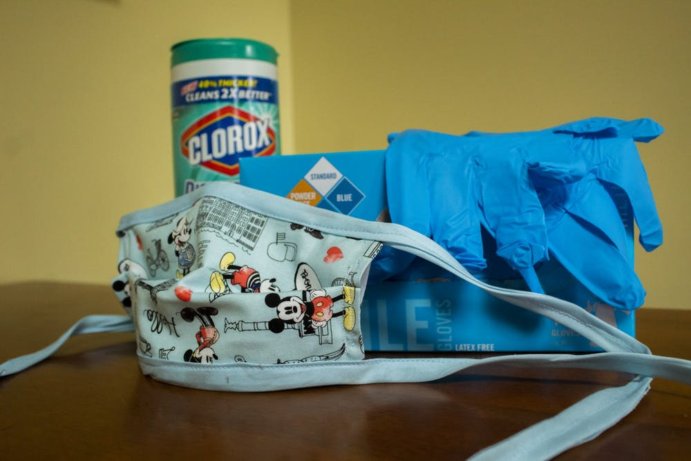<p>Wipes, a mask and gloves sit on a table April 14.</p>