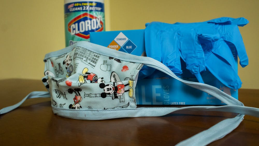 Wipes, a mask and gloves sit on a table April 14.