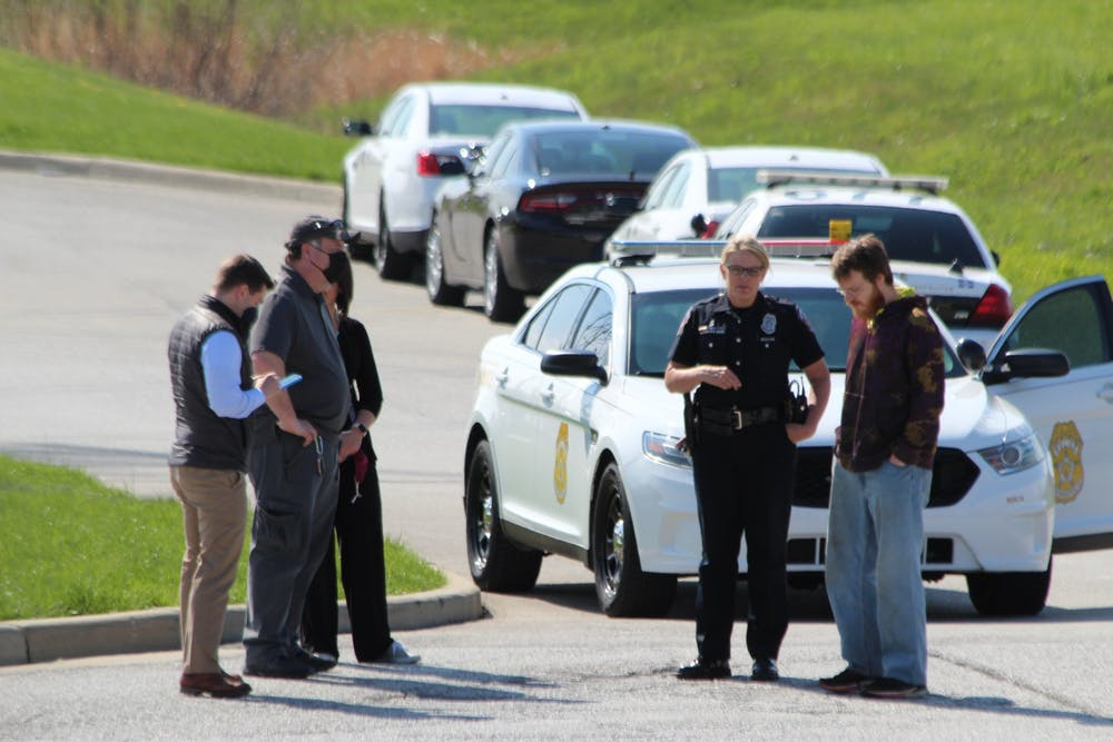 <p>Indianapolis Metropolitan Police personnel talk Friday outside of the FedEx Ground center in Indianapolis. The center was the site of a mass shooting Thursday, where eight people were killed before the gunman killed himself. </p>
