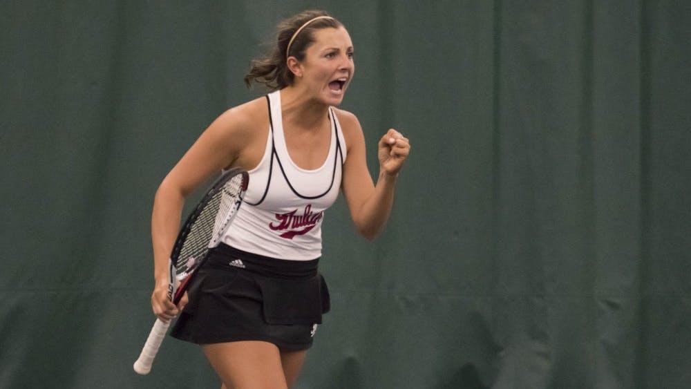 Then-freshman, now-sophomore Michelle McKamey celebrates winning a point during a doubles match last season.