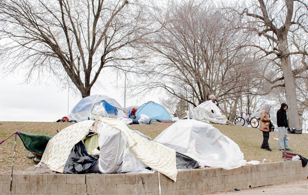 <p>Tents and other shelters are erected in December at Seminary Square Park at 100 W. Second St. Two people experiencing homelessness have died in Bloomington this winter, 49-year-old Iva Chatten and a 51-year-old man named JT. </p>