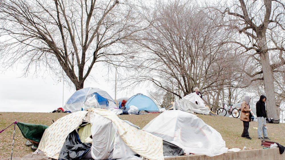 Tents and other shelters are erected in December at Seminary Square Park at 100 W. Second St. Two people experiencing homelessness have died in Bloomington this winter, 49-year-old Iva Chatten and a 51-year-old man named JT.